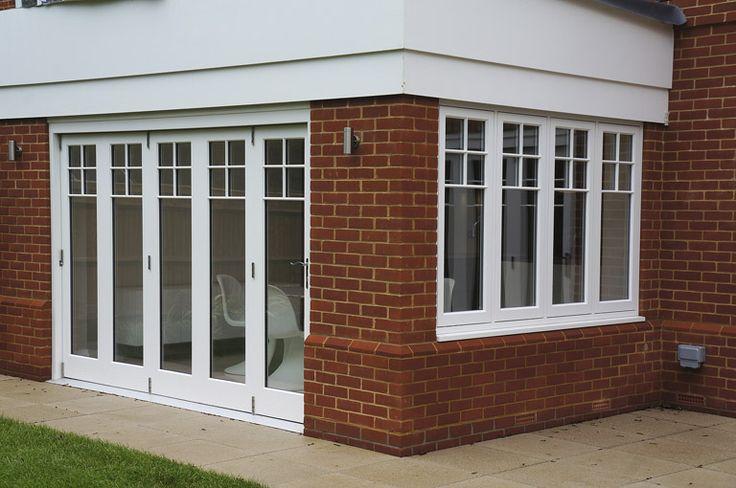 Timber Folding Doors with Edwardian glazing bar design