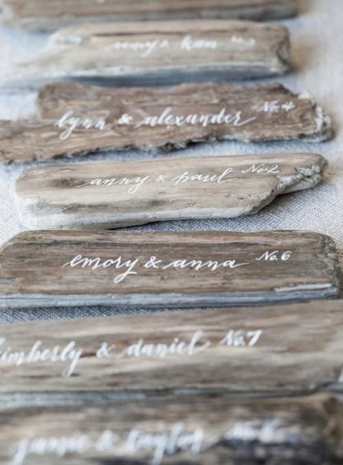 Collect pieces of driftwood from your local beach and have a calligrapher hand-letter each one | Brides.com