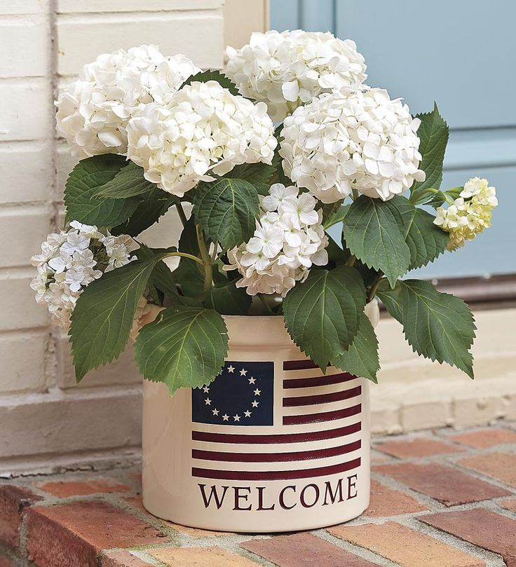 USA-Made Americana Welcome Stoneware Crock. I had mine custom made with our family name on it!