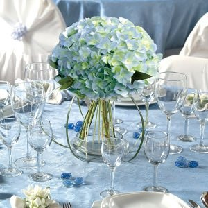 Blue centerpiece bouquet -Simple and could be mixed with other flowers. Blue hyd will be in season.