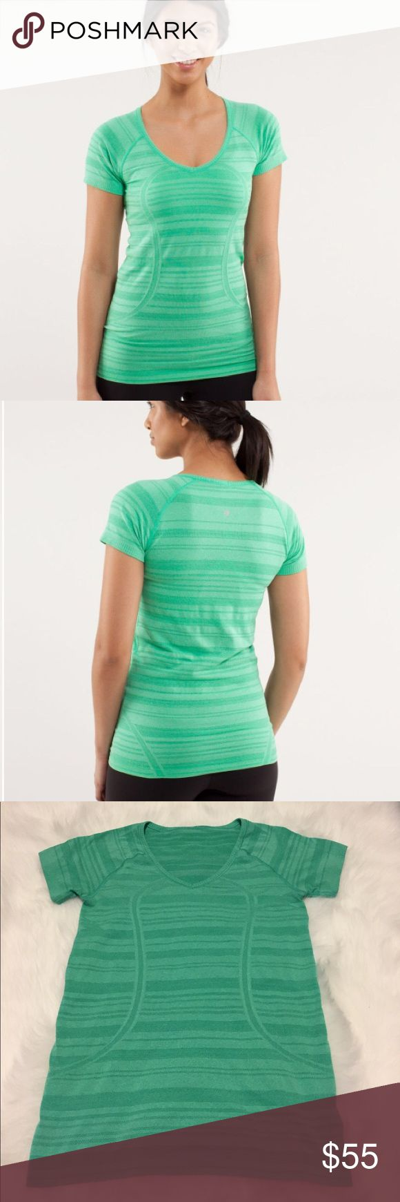 "Lululemon Run: Swiftly Tech V Neck - Very Green Lululemon Run: Swiftly Tech V Neck in Very Green! Love the tonal stripe! Deep V-neck of this anti-stink shirt makes it easy to slip on and off! This shirt stays comfortable when wet & wicks moisture away from our skin. Body is seamless to minimize chafing! Great alone or layered! The Silverescent fabric has anti-odour properties! Size 6. 26"" long & 16"" across. No size tag. Like new!! C2273M431062717 lululemon athletica Tops Tees - Short Sleeve"