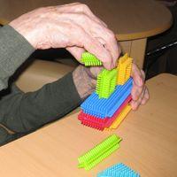 elderly man playing with stickle bricks, dementia, alzheimers activities
