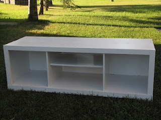 Broken entertainment unit into sturdy bench with storage for books or baskets