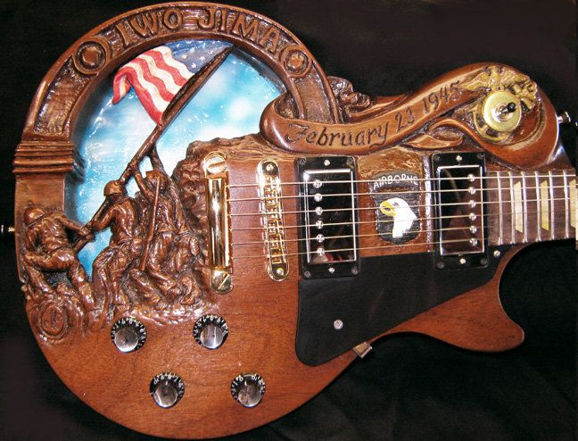 Doug rowell s hand carved electric guitar with patriotic