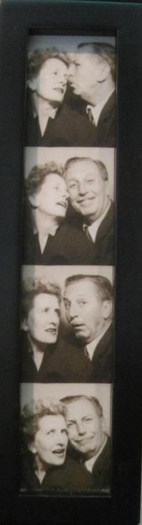 Walt and Lilian Disney spend a moment in a photo booth...