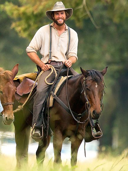 Star Tracks: Wednesday, October 15, 2014 | HORSING AROUND | Liam Hemsworth is all beard and breeches on Wednesday while shooting his new Western, By Way of Helena, in Mississippi.