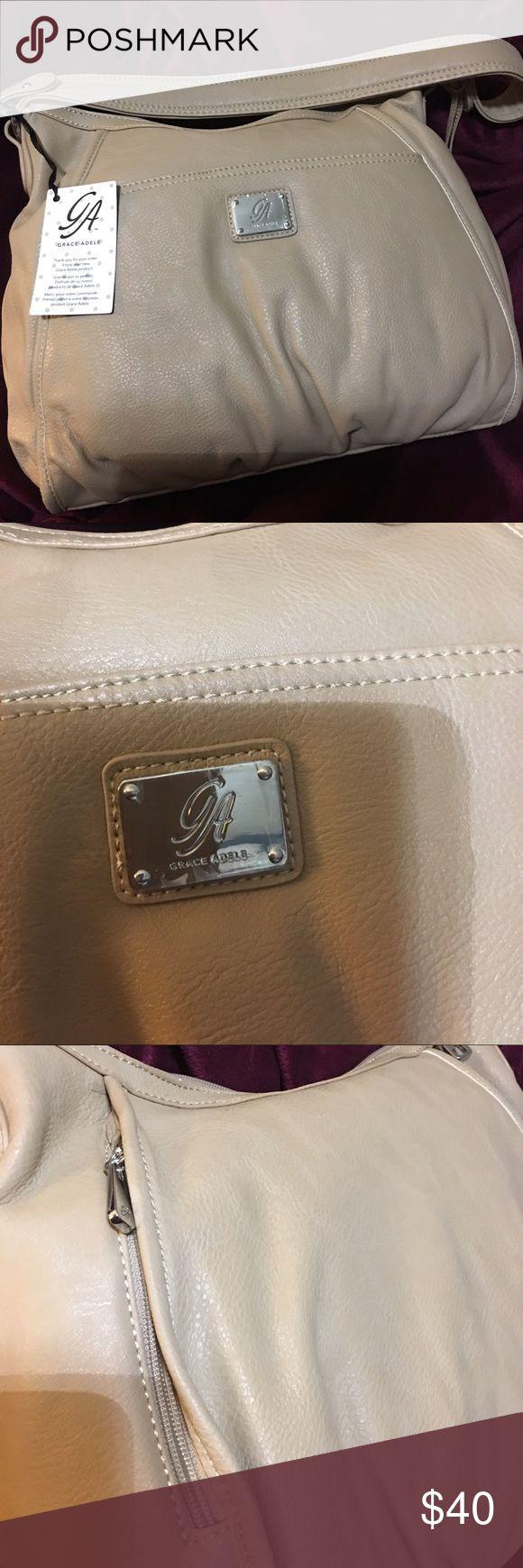 New Tan Grace Adele Purse NWOT Grace Adele Purse, Tan, Front snap pocket, back hidden zip pocket, Grace Adele Bags Shoulder Bags