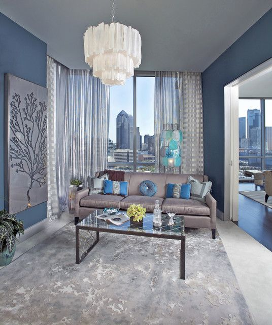 The various use of blues within the space create a peaceful feeling within the space. Also, the blue color pallet opens up the space to make it appear bigger than it really is.