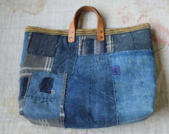 Antique japanese sashiko stitched kasuri textile boro bag
