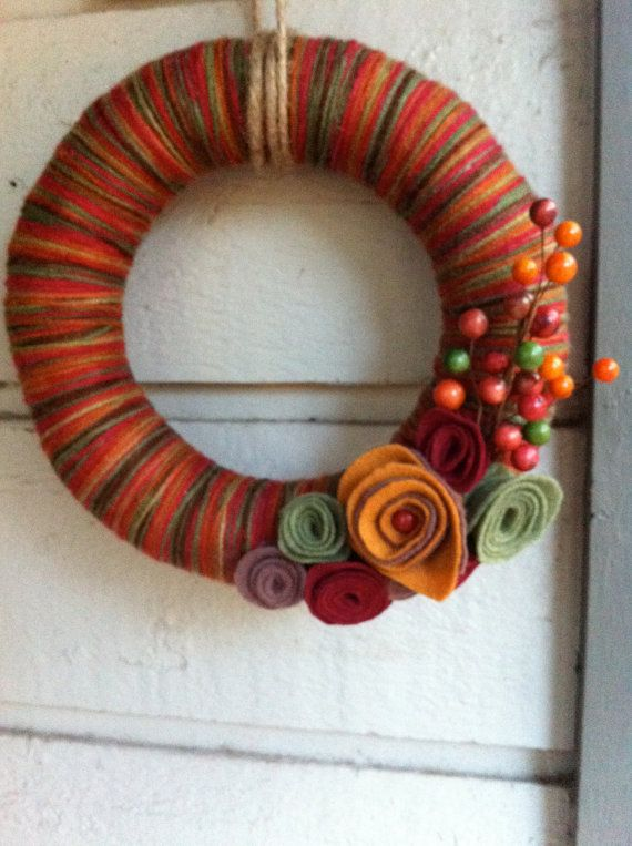 Yarn wreath. love the idea of using variegated yarn depending on what holiday/season you are making it for.
