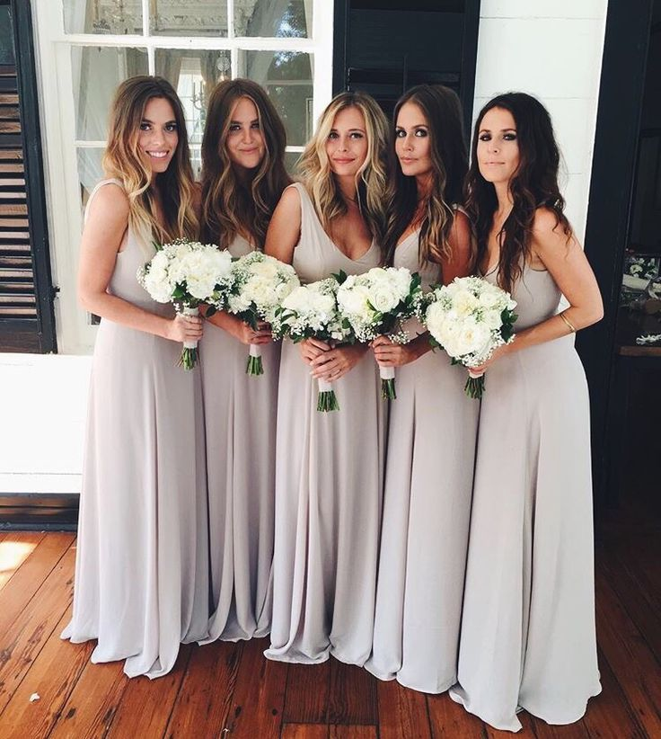 I am loving the neutral bridesmaid dresses. Some people seem to think lighter dresses take away from the bride, but I think it compliments the white dress. Don't you?
