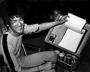 Bruce Lee: Bruce Lee sketching on the set for Game of Death