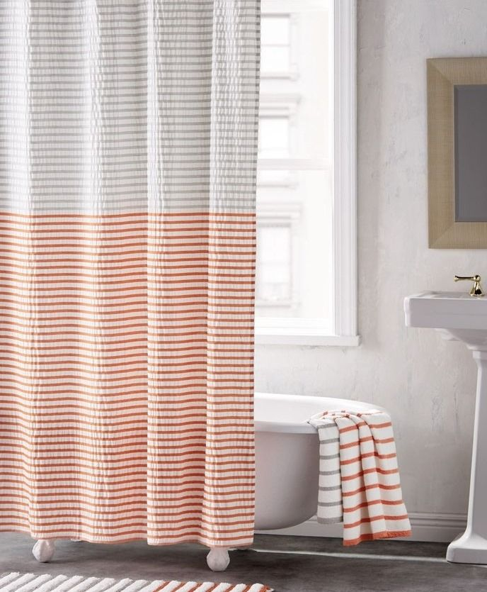 Two-tone stripes play up the modern style of this minimalist shower curtain that pulls together the bathroom décor.