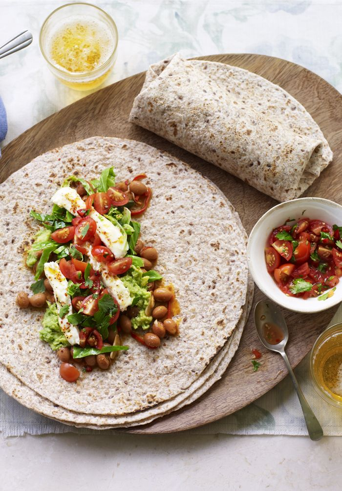 Throw everything at this veggie burrito! Smoky beans, guac, feta - the works!