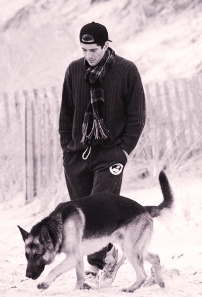 John F. Kennedy, Jr., with a German shepherd. #gsd