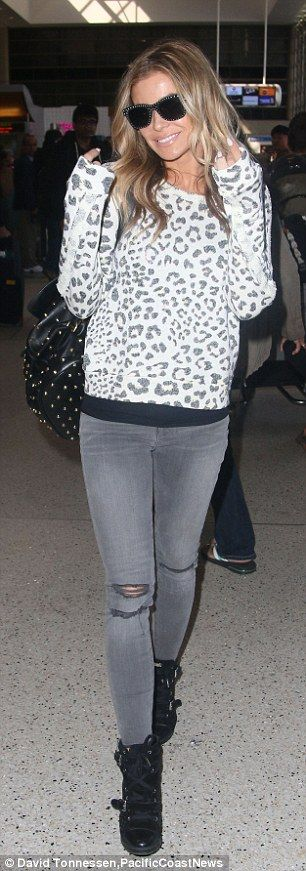 Carmen Electra stands out in leopard-print shirt at LAX #dailymail