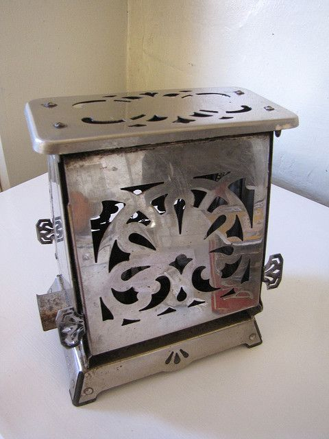 Maybe it was this one that grandma had.  I remember she had to open it and flip the bread so the other side would toast.  Antique toaster