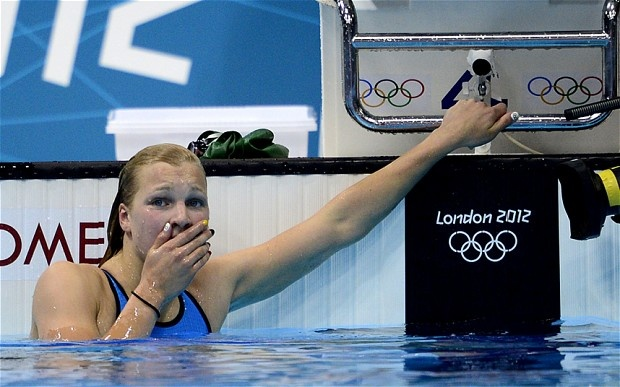 Fifteen year-old Ruta Meilutyte wins the gold medal in a shocker. It is Lithuania's first gold medal in the 100-meter breastroke.