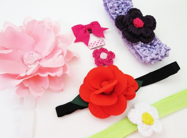 BABY SUMMER HAIR ACCESSORIES all in one pack!  We put this ultimate summer set together with a great variety of colours like red, light pink, white, purple, fuschia and polka dots.  So lively, this summer palette has it all!  You can put on baby headbands, there's 3 baby wisp mini latch clips for your wispy haired baby with hardly any hair at all and also our classic blossom band. Super soft and stretchy!