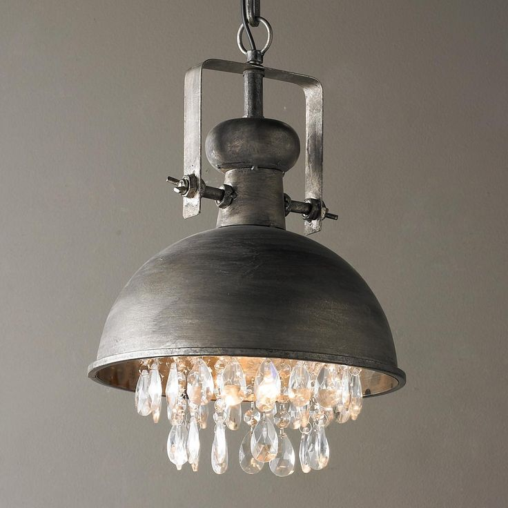 "Industrial Pendant with Crystals This vintage aged steel pendant is warmed by the addition of sparkling faceted crystals underneath for a chic complement to your urban farmhouse, modern industrial or rustic luxe interiors. Includes 31"" of chain from a 5"" round canopy. 1-40watt max medium base bulb. (14""Hx10""W)"