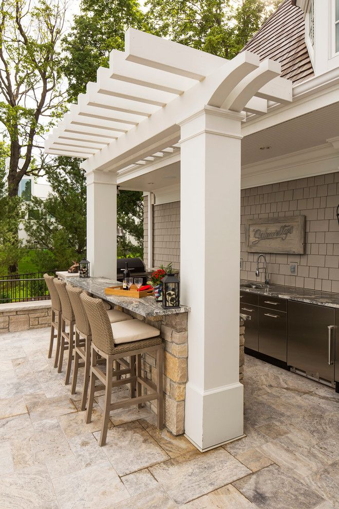 Backyard bar, natural tile floor, semi-covered bar, stone wet bar, stainless steel cabinets | Southview Design