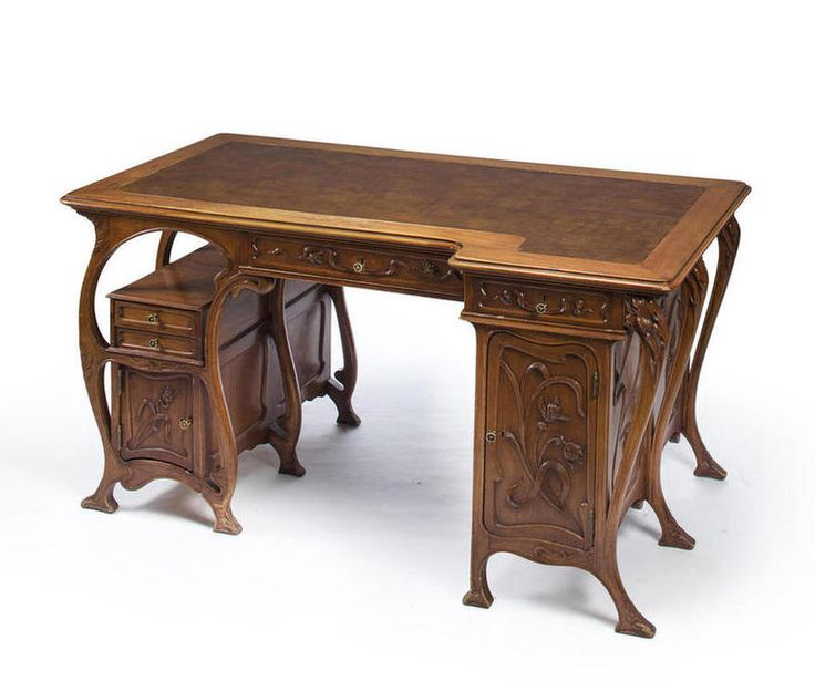 A large Art Nouveau carved mahogany and leather Partners desk circa 1900