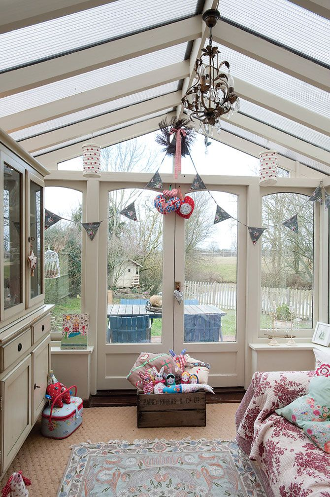 Small, cozy and light-filled family room (sun room).  Looks like it must be in England