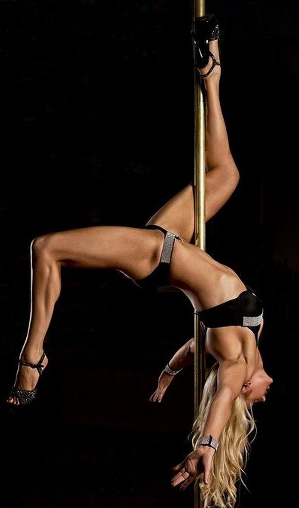 Sexy blonde pole dancer