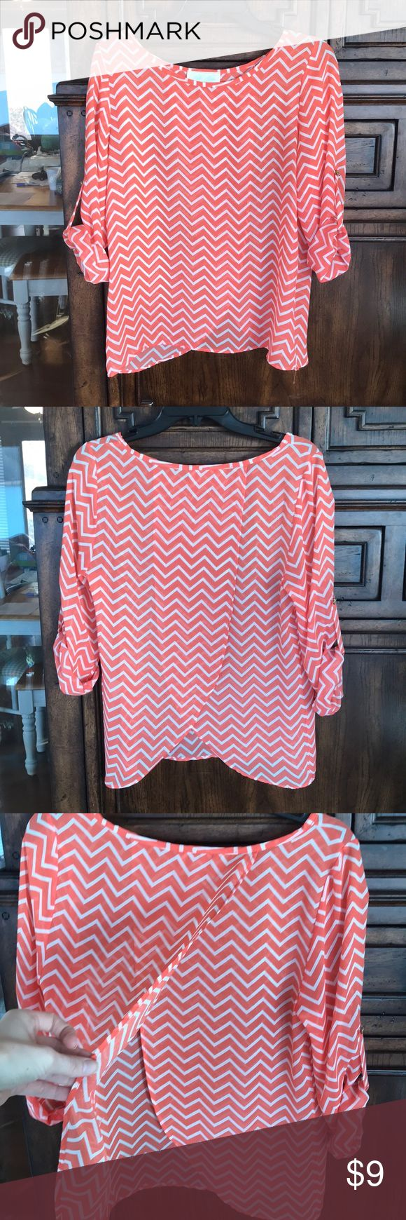 Tilly Anne Size Medium Chevron Top with Cute Back Tilly Anne Chevron Coral Top with Cute back and sleeves that roll and button up! Cute Sheer Top perfect for this spring and summer! VGUC asking $9. Smoke Free Home Tilly Anne Tops