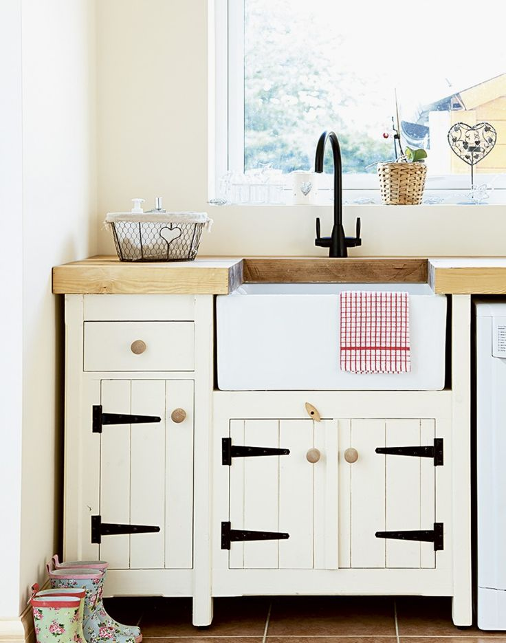 Create pretty country style with a series of cupboards and drawers in Shaker-style cream cabinetry, allowing allocated space for every little thing. Go for pieces that have traditional metal tee hinges for added character and a practical butler sink for a touch of yesteryear. Bring in rustic accessories, such as this wirework basket with a heart motif for peg storage.