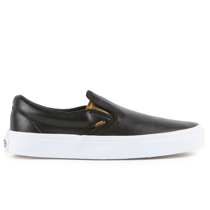The Vans Classic Slip-On Womens Shoes in the (Metallic Gore) Black Colorway features low profile slip-on leather uppers, padded collars, metallic elastic side accents, and signature rubber waffle outs