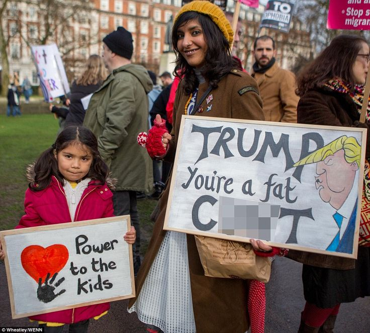 One sign branded the US President a 'fat c**t' at the protest today, which attracted 40,000 into central London