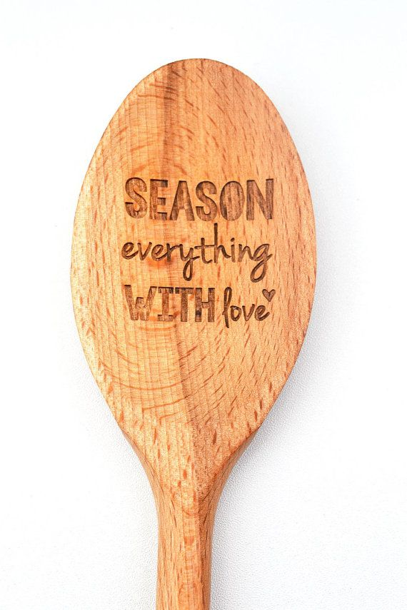 A beech wood kitchen spoon, laser engraved with 'Season with Love'.