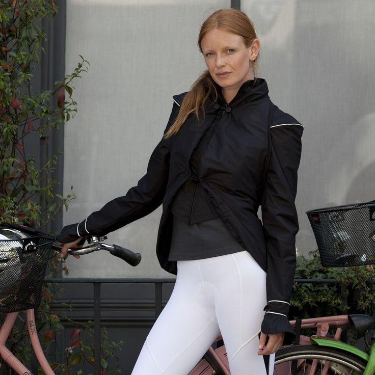 Georgia In Dublin Hustle & Bustle Rain Jacket (Black): Think of your average cycling rain jacket as RyanAir - an occasional necessary evil to get you places in one piece, but hardly glam. Well, Georgia in Dublin's Hustle & Bustle Rain Jacket is Concorde. Beautifully tailored, comfortable and versatile, you can wear it anywhere and always feel elegant and unintimidated by impending rain. It will keep you dry in a rainshower, and protected from the wind, and it's packed with useful features…