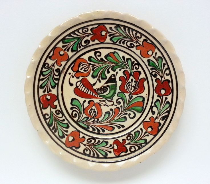 Buy now this Corund ceramic plate with raised painting - Romanian authentic handmade folk art