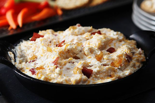 Cream cheese, cottage cheese and cheddar cheese are flavored with turkey bacon, onion, Worcestershire sauce and garlic and baked into a creamy spread.