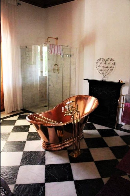 Elegant copper bath at the historical Merindol Manor in the picturesque town of Riebeek-Kasteel.