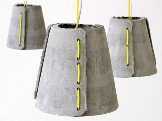From Rainer Mutsch, a limited edition pendant light for outdoor usage consisting of three hand molded fiber-cement shells and sailing rope.