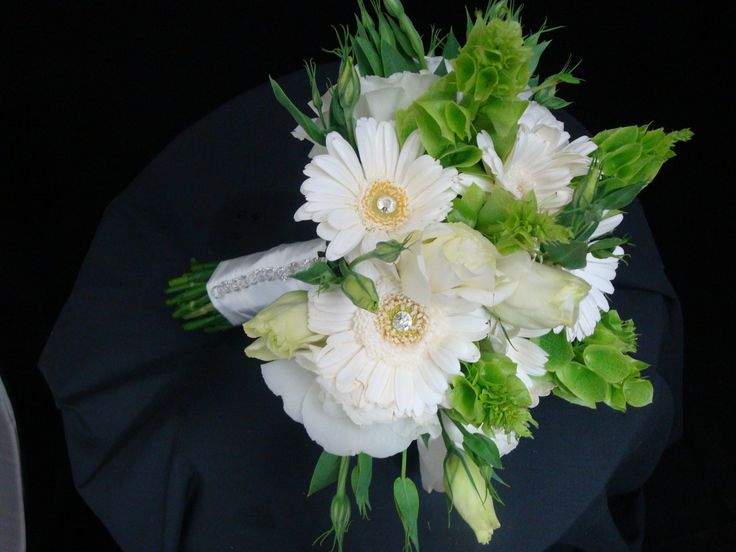 Enchanted Florist Las Vegas- white gerber daisies with white hydrangea and bells of Ireland