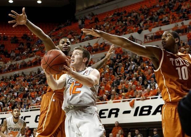 Oklahoma State's Keiton Page (12) goes between Texas' Jaylen Bond (2) and Jonathan Holmes (10) during an NCAA college basketball game between Oklahoma State University (OSU) and the University of Texas (UT) at Gallagher-Iba Arena in Stillwater, Okla., Saturday, Feb. 18, 2012. Oklahoma State won 90-78. Photo by Bryan Terry, The Oklahoman