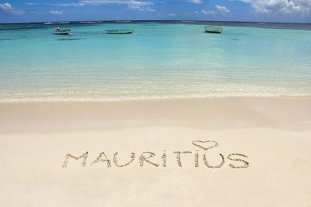 Mauritius - check out this beach pic with turquoise blue lagoon and boats.