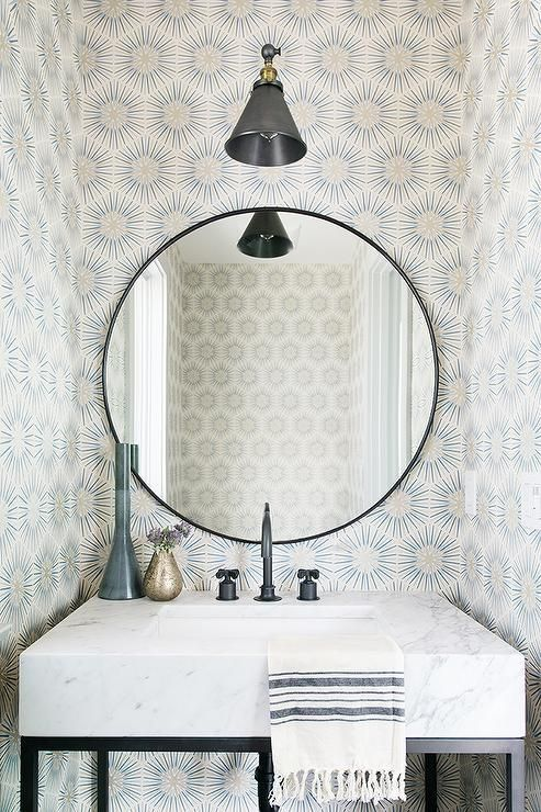 Wonderfully Designed Powder Room Is Lit By A Matte Black Swing Arm