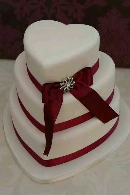 3 layered cake with bloody red  ribbon accent
