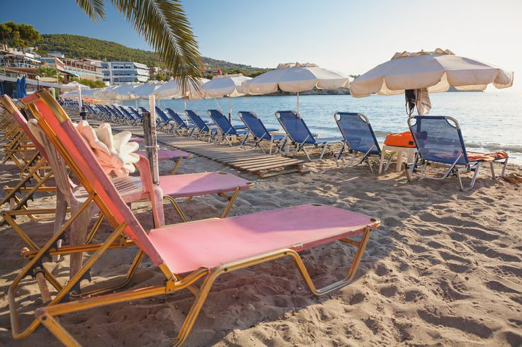 Relax on the long, sandy beach of Agia Marina, Crete, Greece.