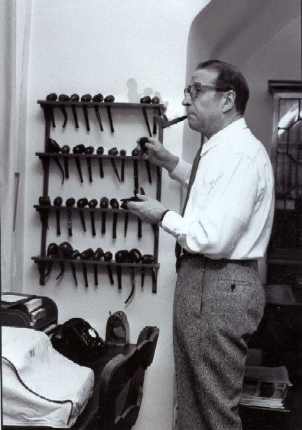 Georges Simenon choosing from his collection of favourite Pipes.