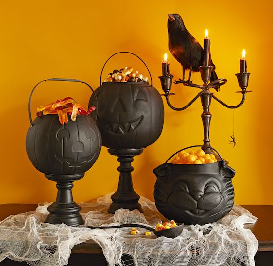 For this year's Halloween party, brew up some tabletop fun: Spray-paint plastic trick-or-treat buckets black, inside and out (flat-finish paint looks spookiest), to transform them into cauldrons. Coat flat-top wooden candle holders (available unfinished at craft stores) with the same paint and attach the cauldrons to their tops with hot glue. Now all that's left [...]