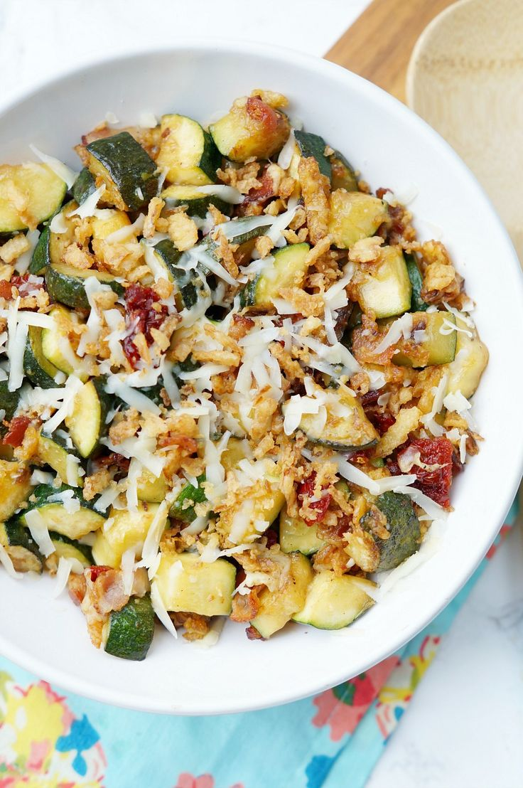Zucchini with Sun Dried Tomatoes, Bacon, and Crispy Onions is a flavor packed side dish recipe your family will ask for again and again this zucchini season!