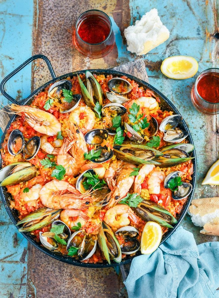 Paella is the perfect one-pan barbecue dish, although it can also be prepared on the stovetop. This simple version is packed with seafood, all you need to accompany it is a sprinkling of parsley, a few wedges of lemon and some good crusty bread – it's the ideal summer seafood dish!