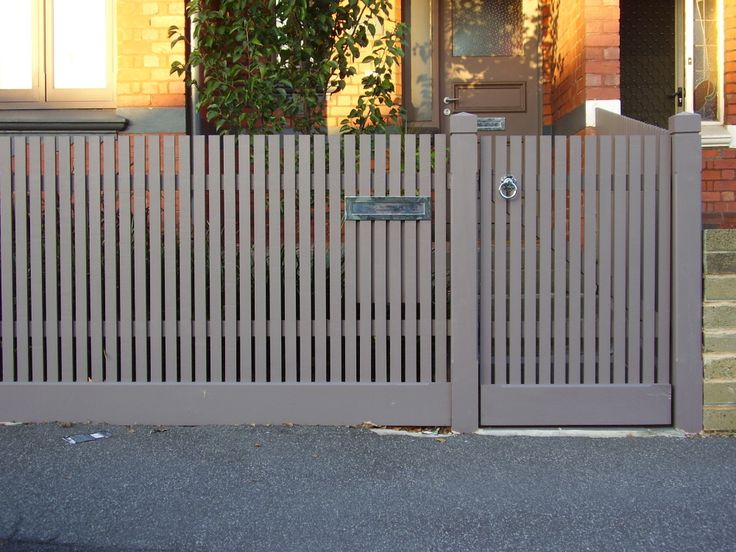 clean and modern painted pickets. like the minimal fuss at the top and broad plank at the bottom