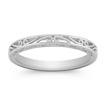 This charming wedding band is crafted in quality 14 karat white gold.  The milgrain detailing gives the design a vintage feel....I want this!!